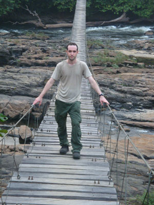 Josh Linder on a bridge in Korup National Park