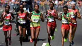 RIO DE JANEIRO, BRAZIL - AUGUST 14:  (L-R) Rose Chelimo of Bahrain, Jemima Jelagat Sumgong of Kenya, Tirfi Tsegaye of Ethiopia, Eunice Jepkirui Kirwa of Bahrain, Mare Dibaba of Ethiopia, and Volha Mazuronak of Belarus compete during the Women's Marathon on Day 9 of the Rio 2016 Olympic Games at the Sambodromo on August 14, 2016 in Rio de Janeiro, Brazil.  (Photo by David Ramos/Getty Images)