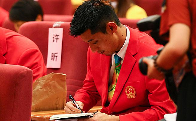 奥运总结大会举行 记者也迷张继科