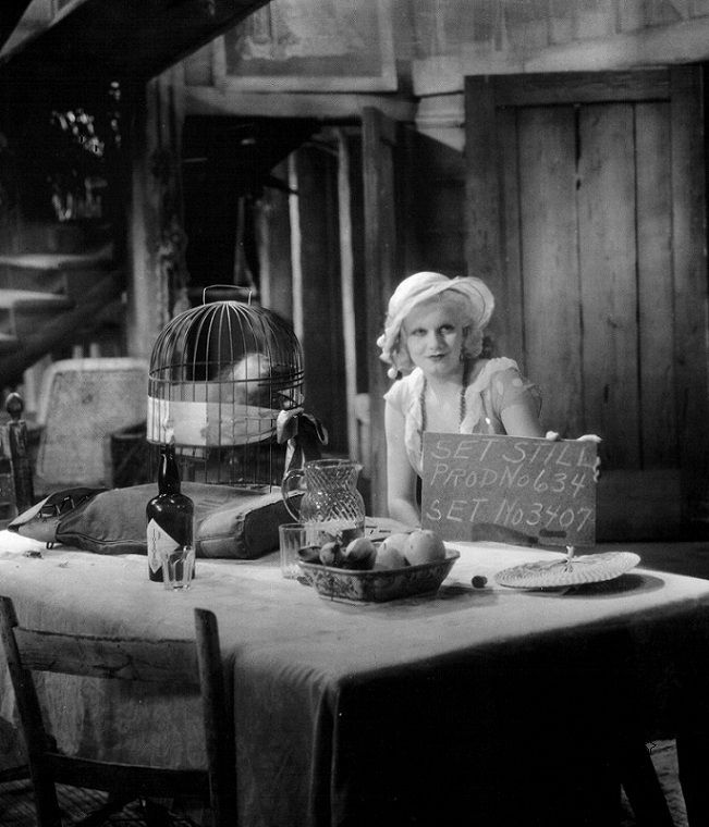 Harlow on the Red Dust set with the parrot cage Astor mentions....