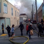 A three-alarm fire raced through a Mission District apartment complex Saturday afternoon. (Photo by Nolan Hicks/ CALIFORNIA BEAT)