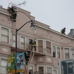 Firefighters responding to a three-alarm fire near 16th and Valencia Sts. in San Francisco's Mission District climb a fire escape.  (Photo courtesy Kate Paloy)