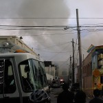 A three-alarm fire raced through a Mission District apartment complex Saturday afternoon. (Photo by Steven Luo / CALIFORNIA BEAT)