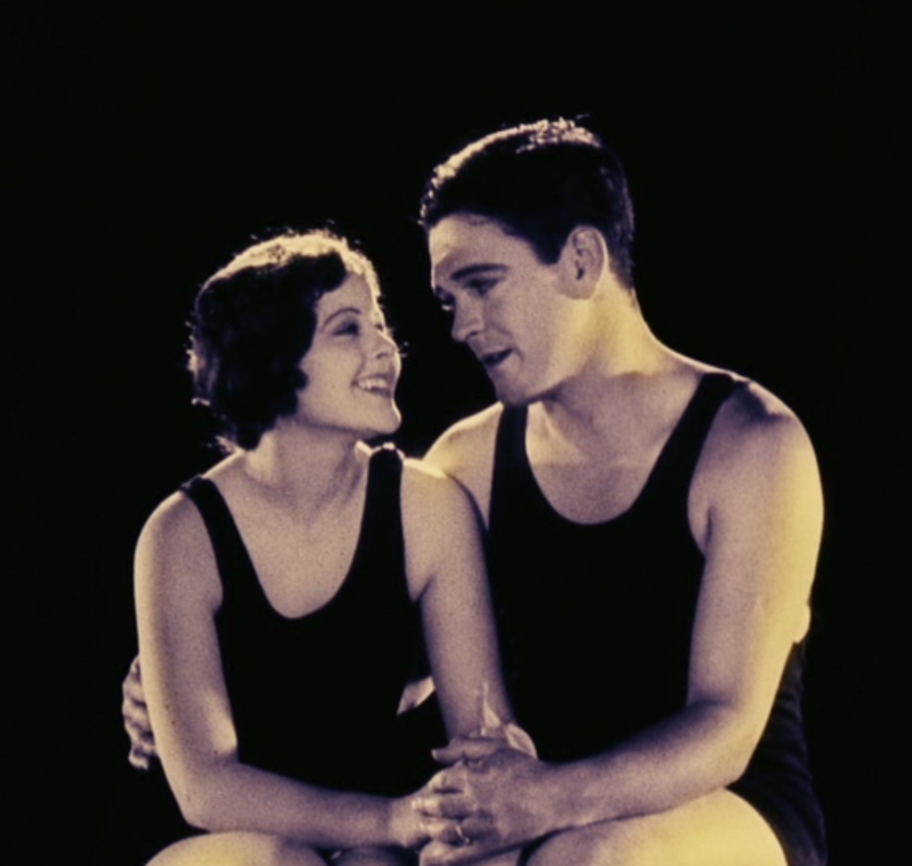 The second and most reviled of the dialogue scenes, and it is the clunkiest and most jarring. The extreme awkwardness and artificiality of the background and the weird echo in the acoustics emphasize how far sound had to go before it could be used naturalistically. Lonesome is a perfect example of the fluency of mature silent film and the primitiveness of early sound.