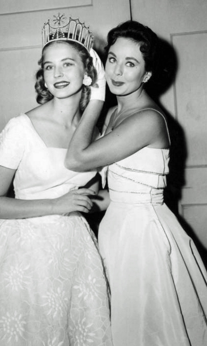 Charlotte Sheffield, Miss USA 1957, of Utah, is crowned by Carol Morris, Miss Universe 1956. From 1952 until 1967, when Miss USA won the Miss Universe title, no one else became Miss USA. After 1967, Miss USA's first runner up accepted the title.(Photo credit: Miss Universe Organization)