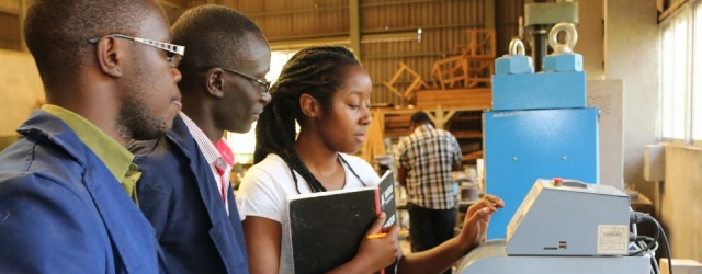 Fifth-Year Civil Engineering Students use a Compression Testing Machine during a practical session