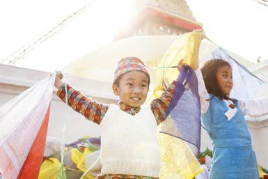 Children and Prayer Flags - © Paper Boat Creative / Getty Images