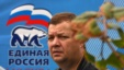 A man walks past an election poster for the United Russia party in central Moscow.