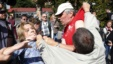 People scuffle in front of the Russian Embassy in Kyiv on September 18. Activists blocked the entrance to the embassy, where a polling station had been set up for Russian citizens to vote in parliamentary elections.