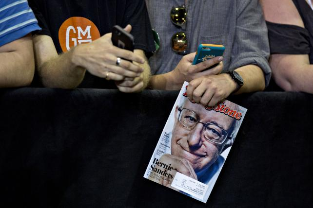 An attendee at a Tampa, Fla., rally for presidential candidate Bernie Sanders holds a copy of Rolling Stone in March.