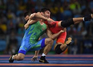 Ganzorig, Mandakhnaran, Navruzov, Ikhtiyor - Wrestling - Mongolia, Uzbekistan - Men's Freestyle 65 kg - MFS 65 kg Bronze - Carioca Arena 2