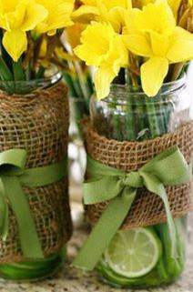 Flower arrangements don't need to be costly and complicated.  Spring daffodils, recycled glass jars, some burlap and scraps of ribbon make great gifts for family and friends.