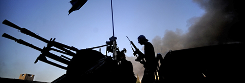Libyan Rebel Tank Returns From Battle