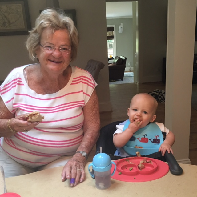 Enjoying a PB and J with his great grandmother, Mema