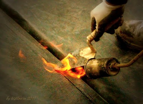 Working with fire: Blowtorch helping