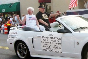Grand Marshall Russell (with Florence) in the lead car of the parade. Taken on Washington st in downtown Norwood on July 4th, 2004.