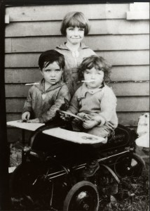 Russell (bottom left) shown with his sister Phyllis (back) and brother Kenny (bottom right)