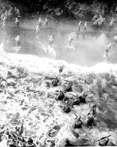 Marines hit three feet of rough water as they leave their LST to take the beach at Cape Gloucester, New Britain