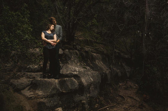A cozy outdoor engagement session at Bull Creek in Austin, Texas