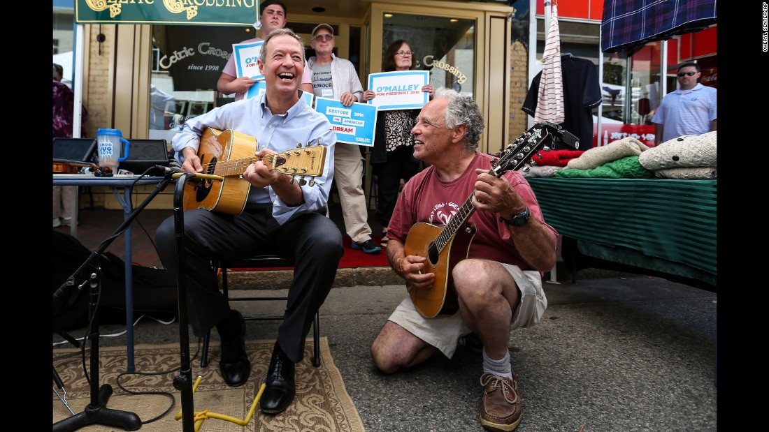"""Democratic candidate Martin O'Malley, left, plays with a borrowed guitar during a meet-and-greet in Portsmouth, New Hampshire, on June 13, 2015. A couple weeks earlier, the former Maryland governor <a href=""""http://www.cnn.com/2015/05/30/politics/martin-omalley-2016-presidential-announcement/"""" target=""""_blank"""">launched his campaign</a> with an appeal to the party's progressive base, hoping to upend the conventional wisdom that Clinton was destined to clinch the Democratic nomination."""