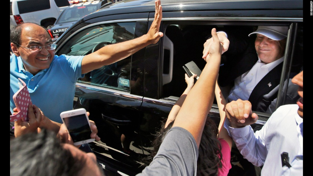 """Supporters reach out to Trump as he leaves a stop in Laredo, Texas, on July 23, 2015. During <a href=""""http://www.cnn.com/2015/07/23/politics/donald-trump-border-visit-texas/"""" target=""""_blank"""">a four-hour visit,</a> Trump met with local officials and toured the border between the United States and Mexico. His visit was the culmination of more than a month of attention centered on Trump's branding of undocumented Mexican immigrants as killers and rapists -- remarks that drew condemnation from the Republican establishment but also helped rocket him to the top of the polls."""