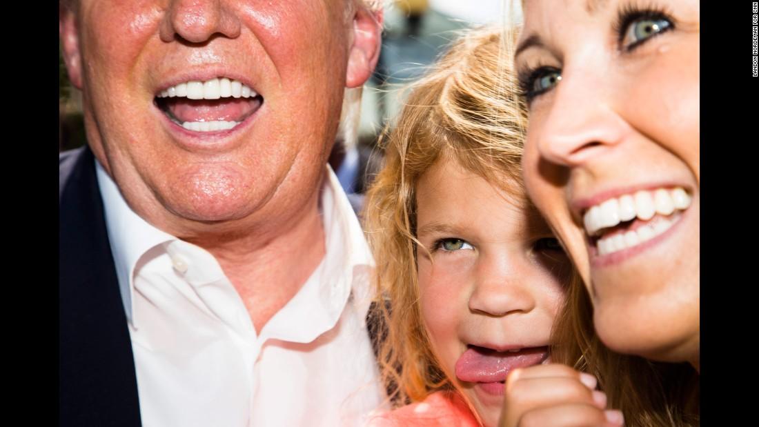 "Trump poses for a picture with a woman and child at <a href=""http://www.cnn.com/2015/08/15/politics/gallery/iowa-state-fair-postcards/index.html"" target=""_blank"">the Iowa State Fair</a> on August 15, 2015."