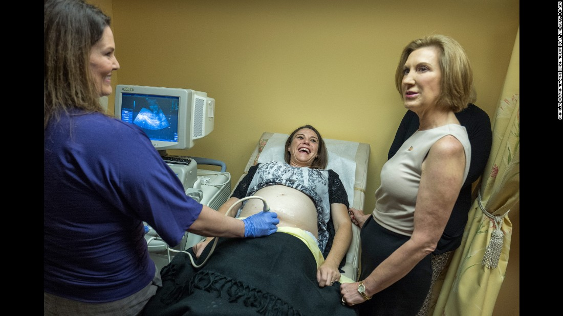 """Republican presidential candidate Carly Fiorina, right, visits a pregnancy center in Spartanburg, South Carolina, on September 24, 2015. Fiorina <a href=""""http://www.cnn.com/2015/09/24/politics/carly-fiorina-planned-parenthood-pregnancy-center/"""" target=""""_blank"""">continued her attacks against Planned Parenthood, </a>which was under fire because of a series of secretly taped, edited videos accusing it of breaking federal laws by profiting off the sale of organs and tissues of aborted fetuses. Planned Parenthood denied it had broken any laws."""