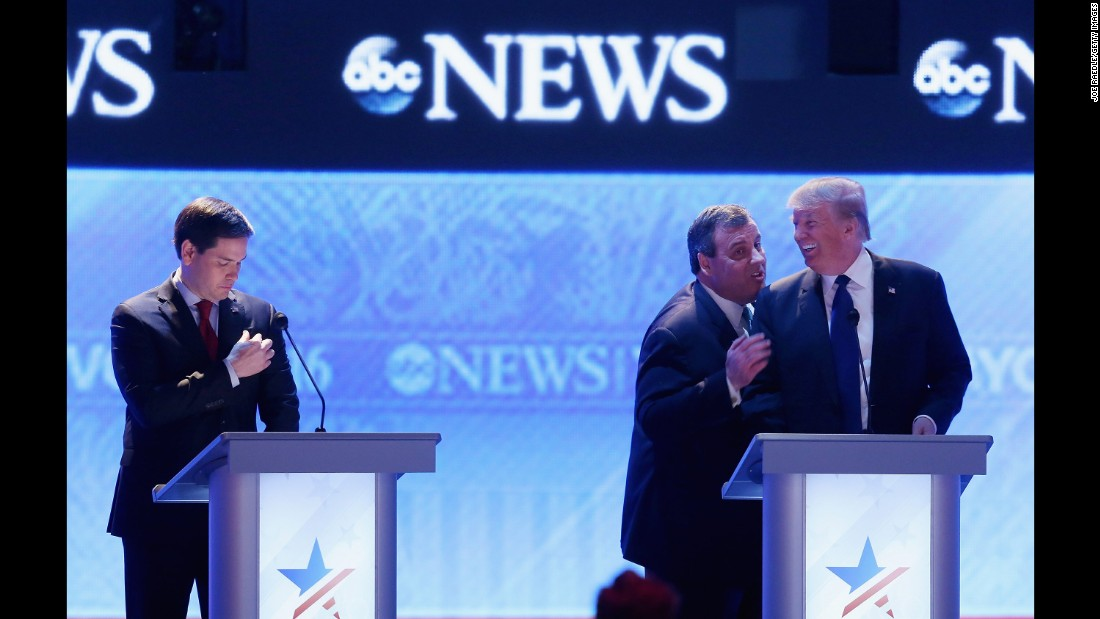 """Trump and Christie talk to each other during a commercial break at the Republican debate in Manchester, New Hampshire, on February 6, 2016. At left is U.S. Sen. Marco Rubio. Trump <a href=""""http://www.cnn.com/2016/02/09/politics/new-hampshire-primary-highlights/"""" target=""""_blank"""">won the New Hampshire primary</a> on February 9 -- his first victory on the way to the nomination."""