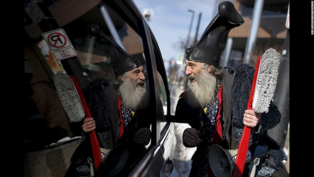 """A performance artist named Vermin Supreme -- <a href=""""http://www.cnn.com/2016/01/21/politics/new-hampshire-primary-lesser-known-candidate-debate/"""" target=""""_blank"""">who officially registered as a presidential candidate</a> -- talks to a motorist as he campaigns in Manchester, New Hampshire, on February 6, 2016."""