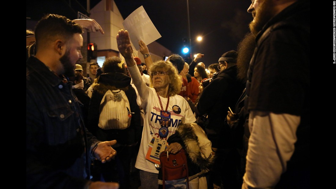 """Trump supporter Birgitt Peterson argues with protesters outside a canceled Trump rally in Chicago on March 11, 2016. Peterson <a href=""""http://www.chicagotribune.com/news/ct-birgitt-peterson-trump-rally-met-0313-20160312-story.html"""" target=""""_blank"""">told the Chicago Tribune</a> that she responded with a Nazi-style salute after anti-Trump protesters called her a Nazi. Trump's campaign <a href=""""http://www.cnn.com/2016/03/11/politics/donald-trump-chicago-protests/"""" target=""""_blank"""">postponed the rally</a> amid fights between supporters and demonstrators, protests in the streets and concerns that the environment at the event was no longer safe."""