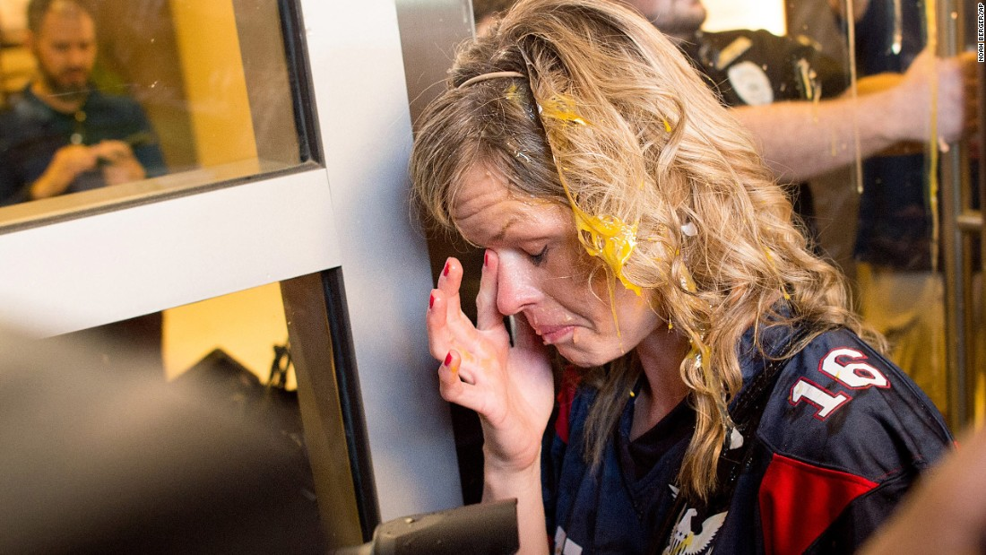 """A Trump supporter wipes egg off her face after <a href=""""http://www.cnn.com/2016/06/09/politics/donald-trump-protests-eggs/index.html"""" target=""""_blank"""">clashes broke out between Trump supporters and Trump protesters</a> in San Jose, California, on June 2, 2016. Trump was holding a rally at the nearby convention center."""