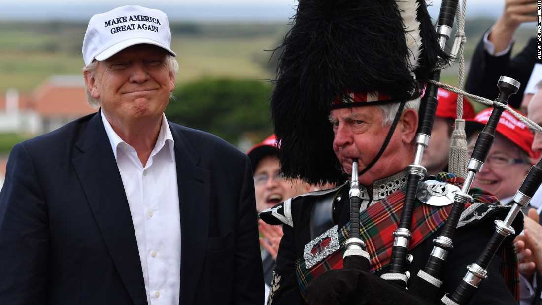 """A man plays the bagpipes next to Trump after the candidate arrived at his Turnberry golf resort in Scotland on June 24, 2016. Trump <a href=""""http://www.cnn.com/2016/05/26/politics/donald-trump-has-delegates-to-clinch-gop-nomination/"""" target=""""_blank"""">became the GOP's presumptive nominee</a> in May."""