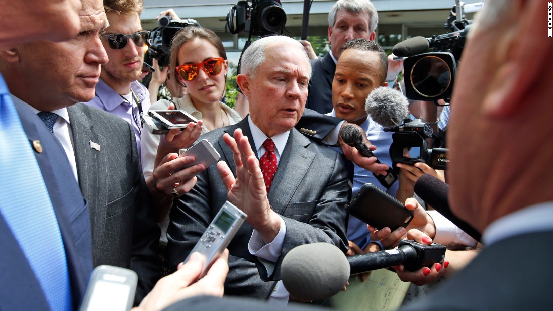 """U.S. Sen. Jeff Sessions, center, talks with reporters after Trump met with the Senate Republican Conference on July 7, 2016. Trump had come to Capitol Hill with the hopes of unifying the party. Sessions, one of Trump's staunchest supporters, argued that Trump had accomplished his goals at the meeting by making a more strenuous effort to bring the party together. <a href=""""http://www.cnn.com/2016/07/07/politics/donald-trump-capitol-hill-republicans/"""" target=""""_blank"""">But there were reports of tension.</a>"""
