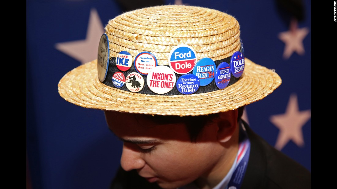 A Republican's hat carries old campaign buttons at the convention in Cleveland.