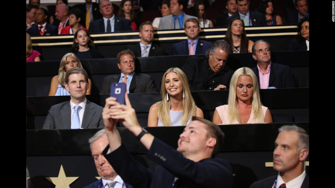 Trump's daughter Ivanka smiles for a man's photo at the convention.