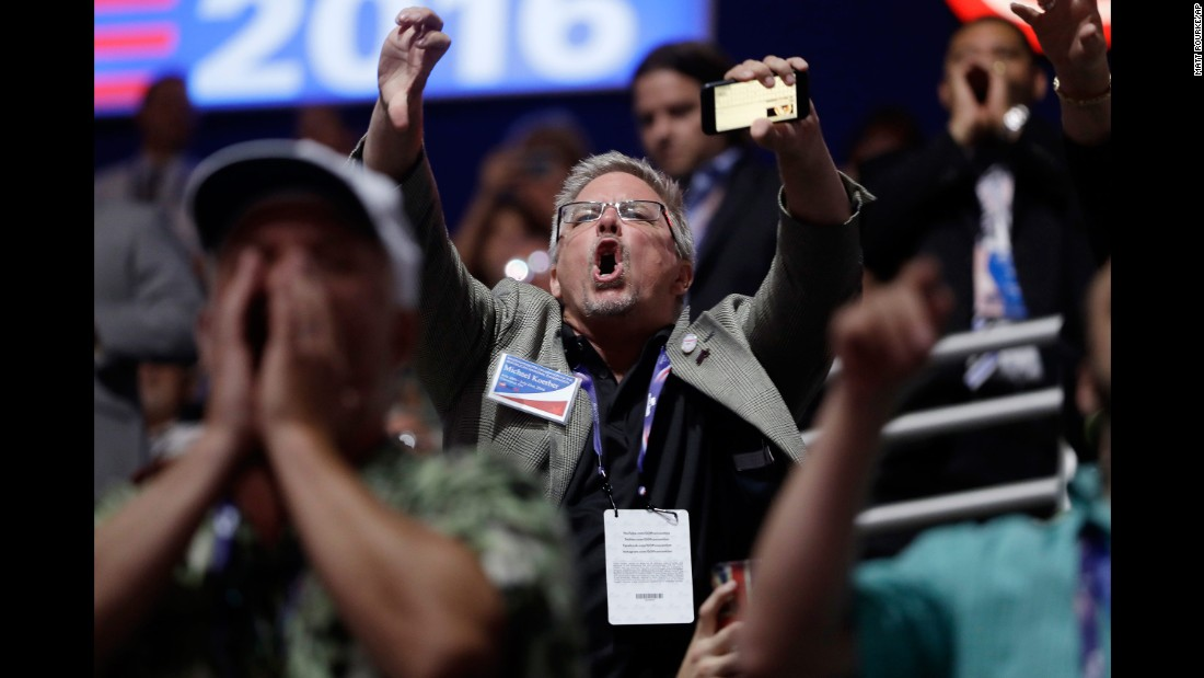 People react to Cruz's speech at the convention on July 20, 2016.