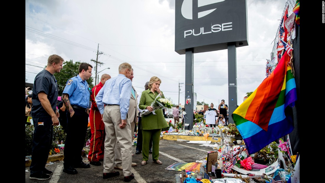 Clinton, accompanied by first responders and U.S. Sen. Bill Nelson, visits a memorial outside of the Pulse nightclub in Orlando on July 22, 2016. The nightclub was the site of a June shooting that killed 49 people.