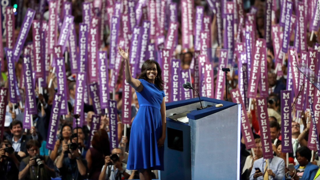 "First lady Michelle Obama waves to delegates in Philadelphia as <a href=""http://www.cnn.com/2016/07/25/politics/michelle-obama-dnc-speech/index.html"" target=""_blank"">she speaks on the first day of the Democratic National Convention</a> on July 25, 2016. Obama cast the presidential race as one between a positive role model for children and a damaging one."