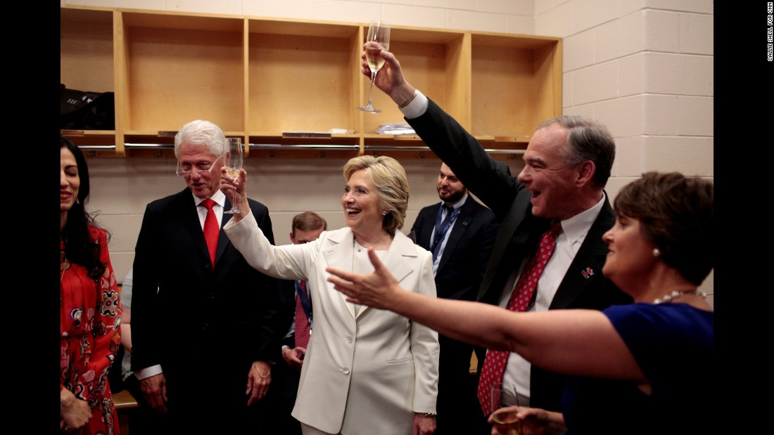 """The Clintons <a href=""""http://www.cnn.com/2016/07/29/politics/cnnphotos-behind-the-scenes-hillary-clinton-dnc/index.html"""" target=""""_blank"""">celebrate backstage</a> with U.S. Sen. Tim Kaine and Kaine's wife, Anne Holton. Kaine is Hillary Clinton's running mate. During the convention, photographer Callie Shell was <a href=""""http://www.cnn.com/2016/07/29/politics/cnnphotos-behind-the-scenes-hillary-clinton-dnc/"""" target=""""_blank"""">behind the scenes with Clinton</a> on assignment for CNN."""