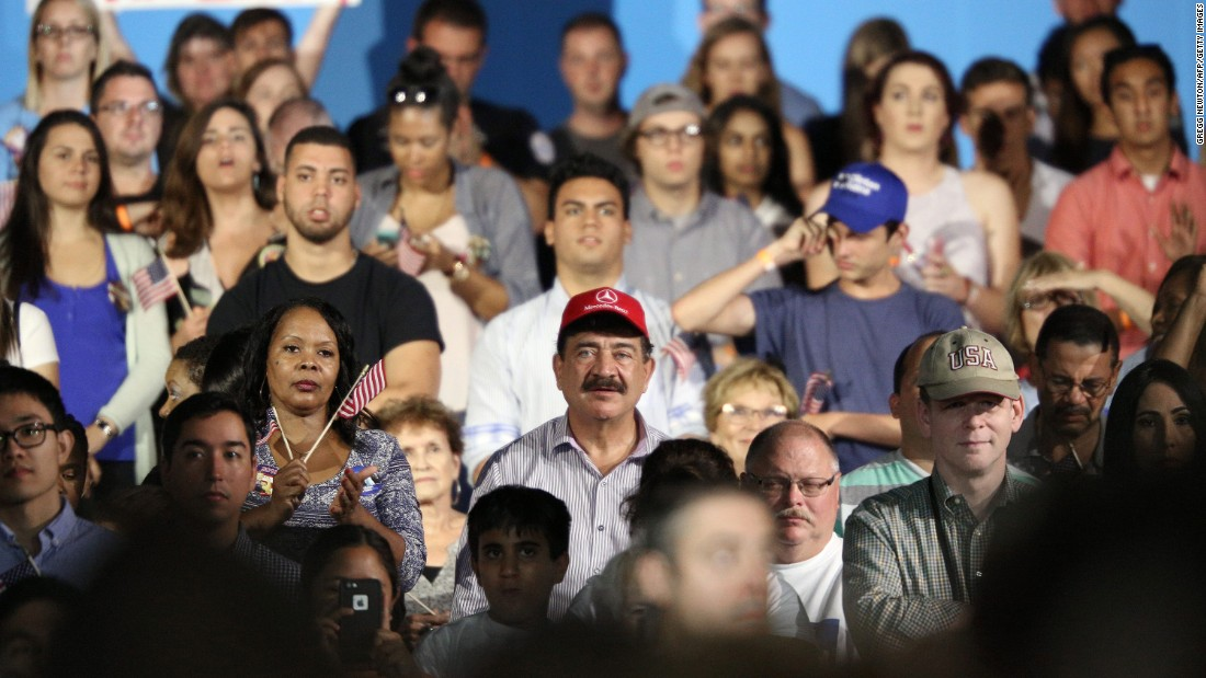 """Seddique Mateen, the father of the gunman who killed 49 people at a nightclub in Orlando, wears a red cap as he <a href=""""http://www.cnn.com/2016/08/09/politics/orlando-gunman-father-clinton/index.html"""" target=""""_blank"""">attends a Clinton campaign rally</a> in Kissimmee, Florida, on August 8, 2016. A Clinton aide said the campaign was unaware of Mateen's attendance until after the event. Clinton spokesman Nick Merrill later issued a statement saying, """"Hillary Clinton disagrees with his views and disavows his support."""""""