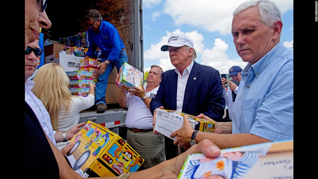 """Trump and Pence help unload supplies for flood victims during a visit to Gonzales, Louisiana, on August 19, 2016. The two were in the state following <a href=""""http://www.cnn.com/2016/08/21/politics/louisiana-governor-donald-trump-visit-helpful/index.html"""" target=""""_blank"""">massive flooding</a> in and around Baton Rouge."""