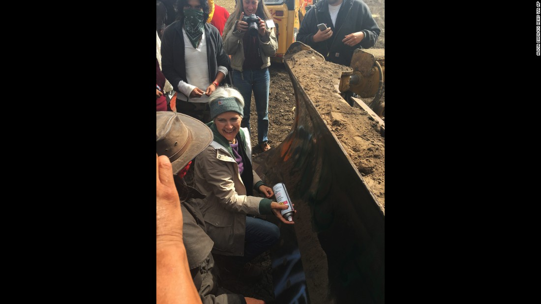 """Jill Stein, the Green Party's presidential candidate, spray-paints a bulldozer <a href=""""http://www.cnn.com/2016/09/07/politics/jill-stein-pipeline-protest-trespassing-charges/index.html"""" target=""""_blank"""">during a protest against the Dakota Access Pipeline</a> in Morton County, North Dakota, on September 6, 2016. A North Dakota sheriff's office charged Stein and her running mate, Ajamu Baraka, with criminal trespass and criminal mischief. Stein, who has a history of environmental activism, said the pipeline's construction desecrated Native American burial sites."""