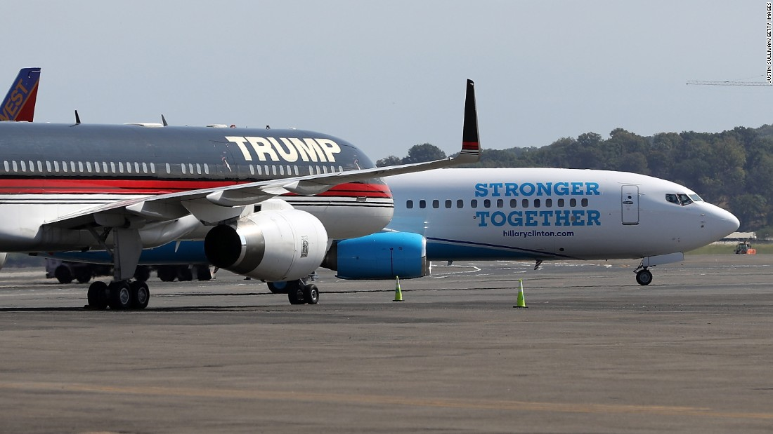 The campaign planes of Trump and Clinton sit on the tarmac at Reagan National Airport near Washington on September 16, 2016.