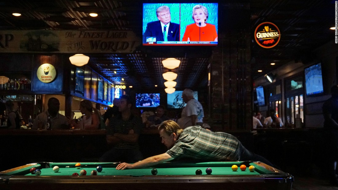 """The <a href=""""http://www.cnn.com/2016/09/26/politics/gallery/first-presidential-debate/index.html"""" target=""""_blank"""">first debate between Trump and Clinton</a> is seen on television at a bar in San Diego on September 26, 2016."""
