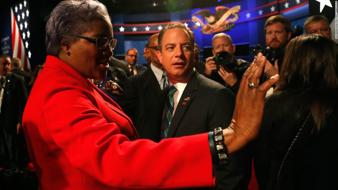 """Donna Brazile, acting chairwoman of the Democratic National Committee, talks with Reince Priebus, chairman of the Republican National Committee, before the vice presidential debate. Brazile <a href=""""http://money.cnn.com/2016/10/31/media/donna-brazile-cnn-resignation/index.html"""" target=""""_blank"""">later resigned from her role as a CNN contributor </a>amid fresh revelations that she sent questions to Clinton's campaign in advance of a CNN debate and a CNN-TV One town hall. In a statement, CNN said it was """"completely uncomfortable with what we have learned about her interactions with the Clinton campaign while she was a CNN contributor."""" CNN said it """"never gave Brazile access to any questions, prep material, attendee list, background information or meetings in advance of a town hall or debate."""""""