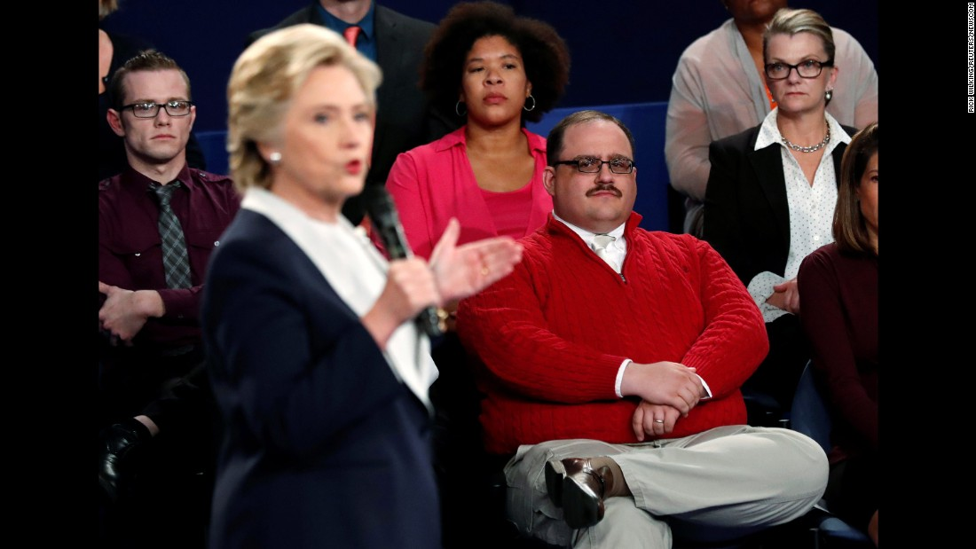 """Undecided voter Ken Bone, in the red sweater, listens to Clinton during the second debate. Bone <a href=""""http://www.cnn.com/2016/10/10/politics/ken-bone-reveals-new-details-from-debate/index.html"""" target=""""_blank"""">became a viral sensation</a> after asking his question about the two candidates' energy policies."""