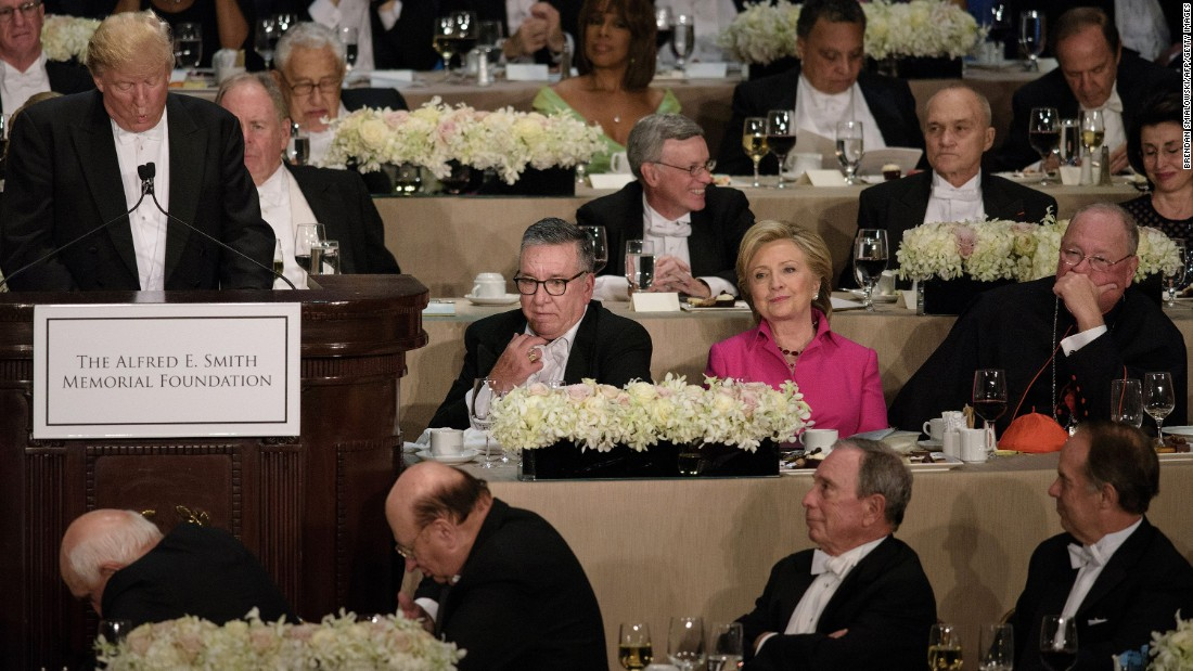 "Clinton listens to Trump speak at <a href=""http://www.cnn.com/2016/10/20/politics/al-smith-dinner-hillary-clinton-donald-tump/index.html"" target=""_blank"">the Al Smith charity dinner</a> in New York on October 20, 2016. The annual event benefits Catholic charities and is often one of the final opportunities for presidential candidates to share a stage before the election. Historically, it has been a good-natured roast -- but CNN's Stephen Collinson said Clinton and Trump <a href=""http://www.cnn.com/2016/10/21/politics/al-smith-dinner-hillary-clinton-donald-trump-campaign/index.html"" target=""_blank"">struggled to disguise the anger, bitterness and sheer open dislike</a> that has pulsed through the race."