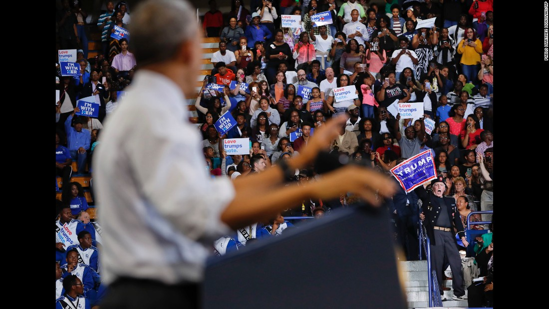"""A Trump supporter <a href=""""http://www.cnn.com/2016/11/04/politics/obama-north-carolina-donald-trump-protester/"""" target=""""_blank"""">interrupts President Obama's speech</a> during a Clinton campaign rally in Fayetteville, North Carolina, on November 4, 2016. Obama rebuked the crowd for shouting down the protester, saying """"we live in a country that respects free speech."""" He added that the man looked like he possibly served in military and that """"we ought to respect that."""" The episode lasted for more than a minute before the Trump supporter was escorted from the venue."""