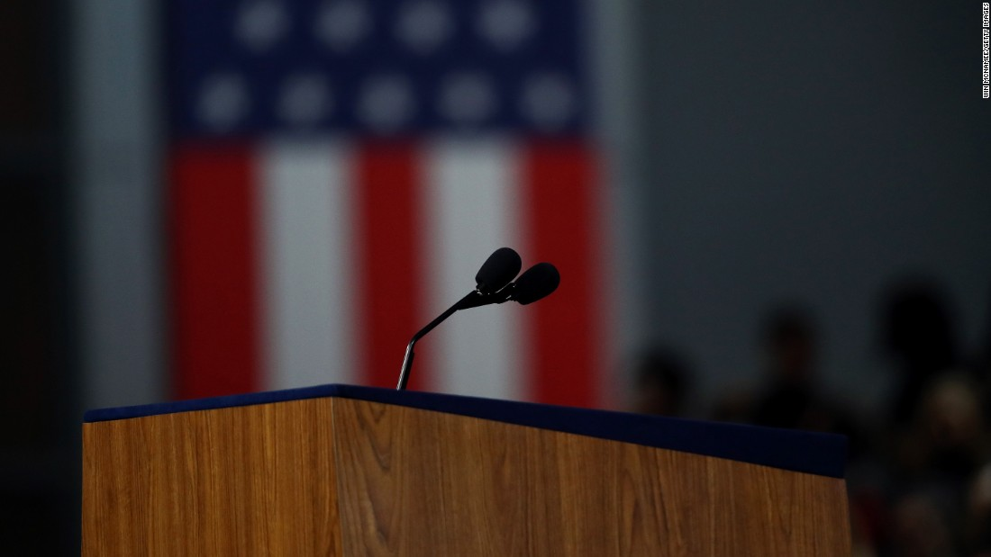 An empty lectern is seen at the Javits Center -- the site of Clinton's election night gathering in New York -- on November 9, 2016. With Clinton trailing in the Electoral College and a few remaining states too close to call, Clinton's campaign chief, John Podesta, announced that Clinton would not be giving a speech to the crowd. She later called Trump to concede the election.