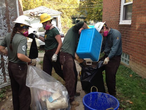 Montana Conservation Corps members cleaning out flood affected homes